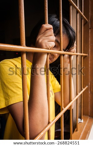 asian girl Hand in jail - stock photo