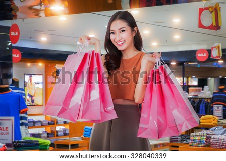 Asian girl happy enjoy shopping in department store - stock photo