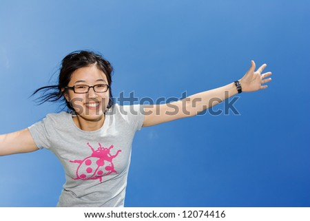 Asian girl having fun, sky on the background - stock photo