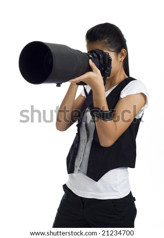asian girl holding a dslr cam with an 300mm tele lens attached - stock photo