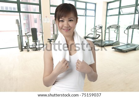 asian girl in a gym - stock photo