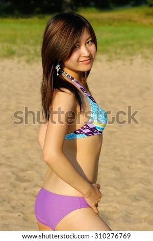 Asian girl in bikini - stock photo