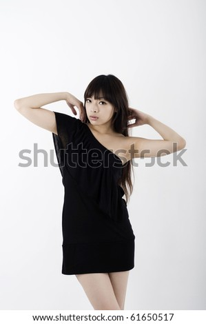 Asian girl in black clubbing dress dancing - stock photo