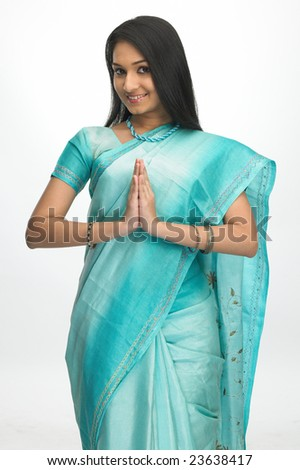 Asian girl in green sari with welcome expression - stock photo