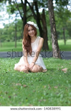 Asian girl in park - stock photo