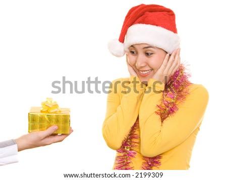 Asian girl in santa's hat receiving christmas present - stock photo