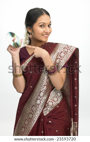 asian girl in sari showing the cd - stock photo