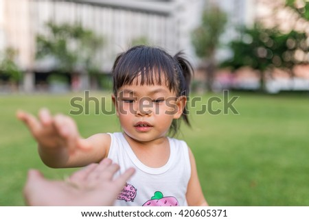 Asian girl is giving something