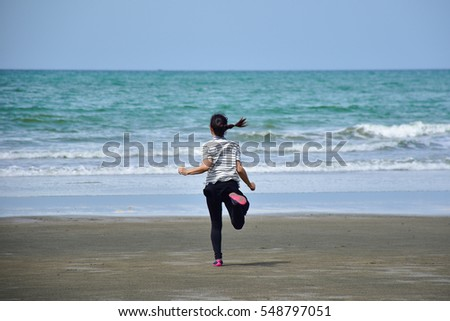 asian girl is running on the beach into the sea, excited, sad, disappoint emotions