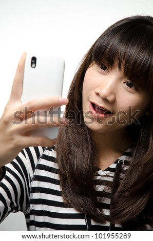 Asian girl is taking her photo with the smartphone - stock photo