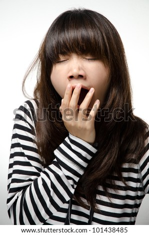 Asian girl is yawning - stock photo