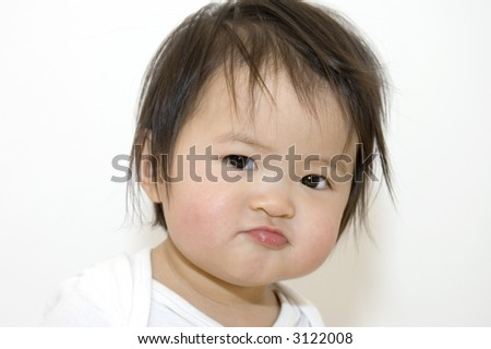 asian girl looking angry - stock photo