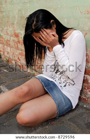 Asian girl looking depressed - stock photo