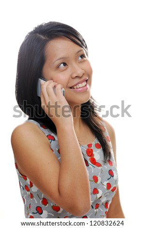 Asian girl looking happy and talking on mobile phone