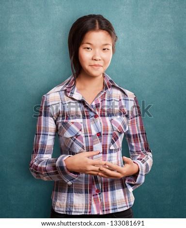 Asian girl looking on camera and smiling - stock photo