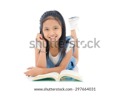 Asian girl lying on the floor and reading