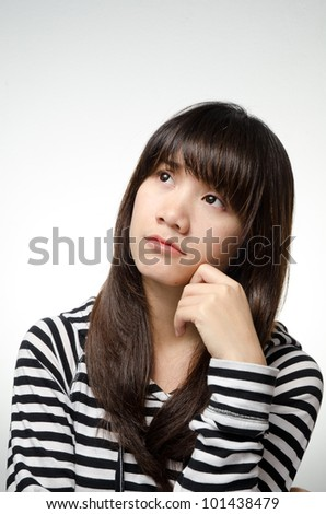 Asian girl on black and white shirt is thinking - stock photo