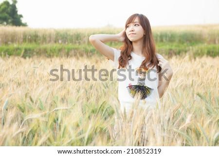 Asian girl on meadow  - stock photo