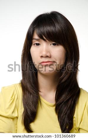 Asian girl on yellow shirt do a bored face - stock photo