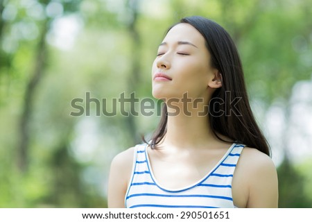 asian girl outdoor breathe fresh air in the park