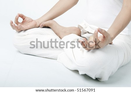 asian girl performing yoga  meditation close up shot on hand and sitting position - stock photo