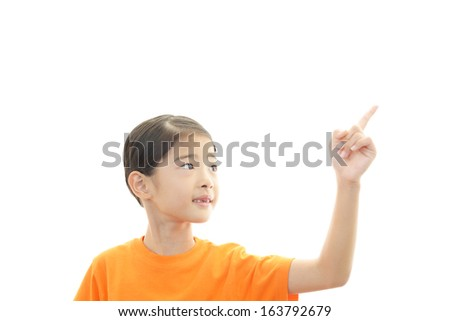 Asian girl pointing - stock photo