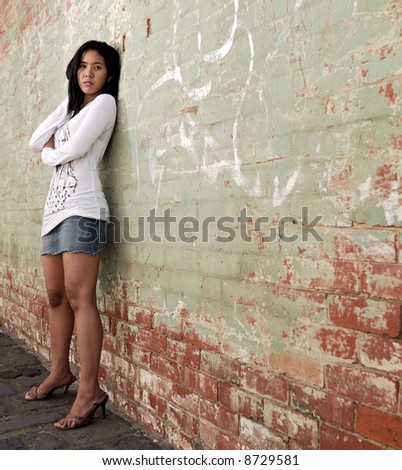 Asian girl posing in alley - stock photo