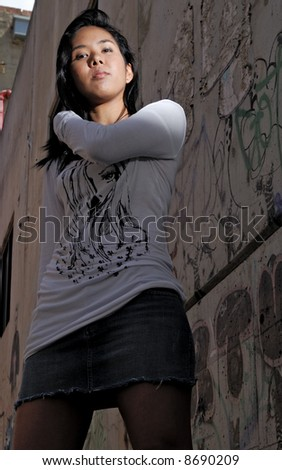 Asian girl posing in urban environment