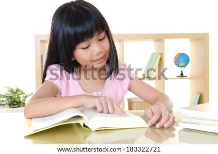 Asian girl reading a book - stock photo