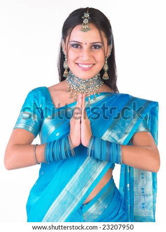 Asian girl saying welcome by folding both  her hands - stock photo