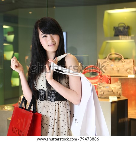 asian girl shopping - stock photo