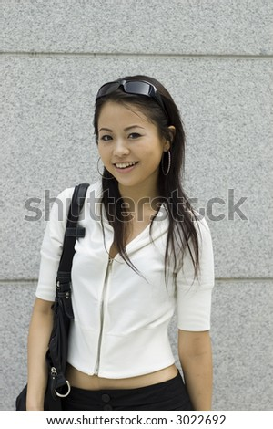 Asian girl shopping in mall - stock photo
