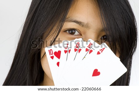 asian girl showing a royal flush - stock photo