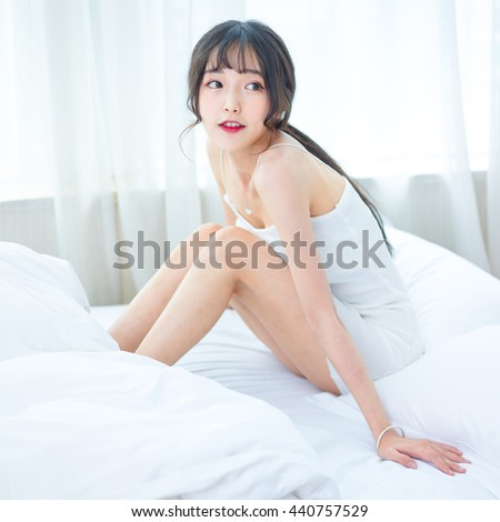 asian girl sitting on bed  at home  japanese style - stock photo