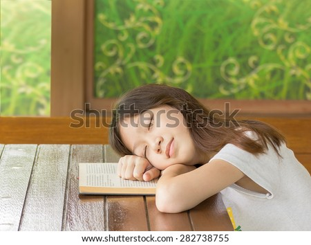 Asian girl sleeping while sitting at desk,Sleeping while learning - stock photo