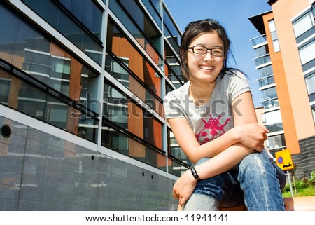 Asian girl smiling in the yard - stock photo
