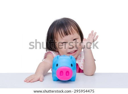 Asian girl smiling with piggy bank over white