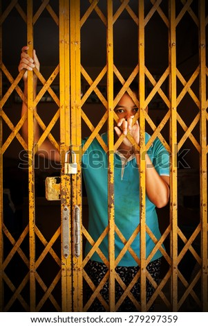 asian girl standing alone in home and Hand in jail - stock photo