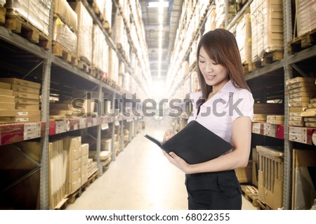 asian girl stock counting in warehouse