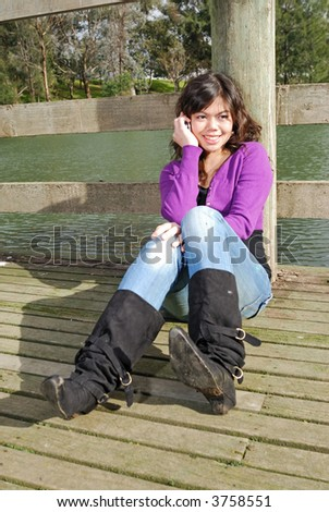 Asian girl talking on the phone - stock photo
