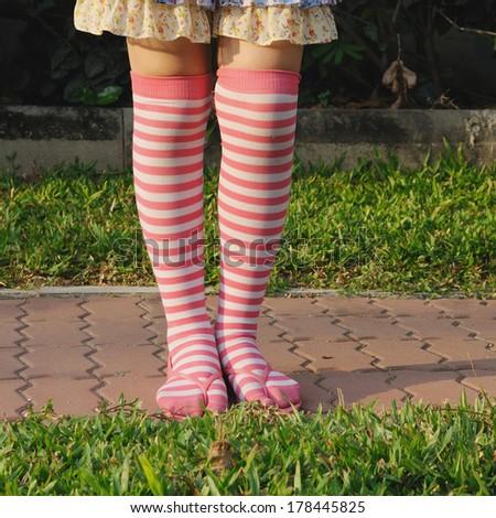 Asian girl wearing pink stockings. - stock photo