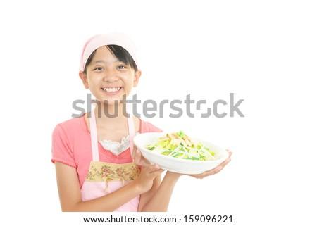 Asian girl who enjoy cooking - stock photo