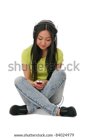 Asian girl with cell phone listen music - stock photo