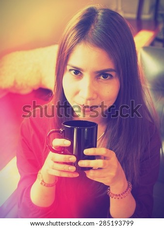 Asian  girl  with cup of coffee vintage  color tone