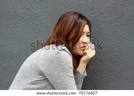 Asian girl with frightened face - stock photo