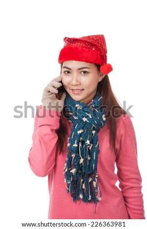 Asian girl with red christmas hat talk on mobile phone  isolated on white background