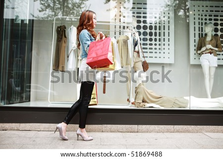 asian girl with shopping bags - stock photo