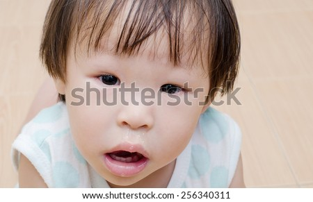 Asian girl with snot flowing from her nose
