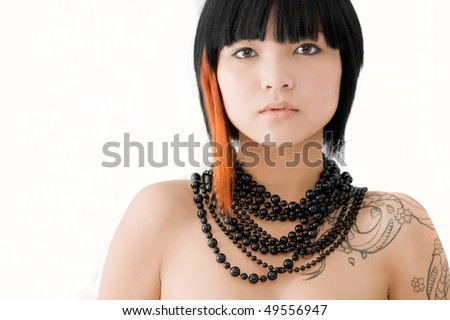 Asian girl with stylish hair on white studio background