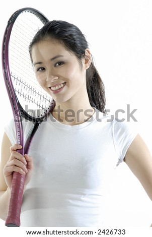 Asian girl with tennis racket - stock photo